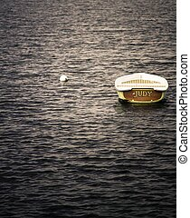 moored skiff at sunset - Small skiff moored on calm lake at...