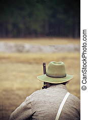 Civil War re-enactment: a scout for the Confederacy watches...