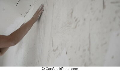 house-painter putties a wall