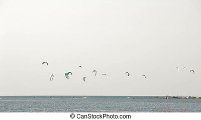 Paragliding sport - People practicing paragliding sport...