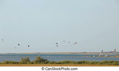 Paragliders above the sea