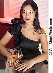 woman with glass of brandy