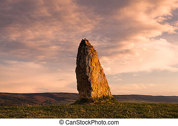 The menhir - Menhir on the hill at sunset in Morinka in...