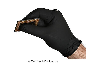 black gloves holding semiconductor