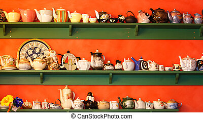 Collection of teapots on shelf - A large collection of...