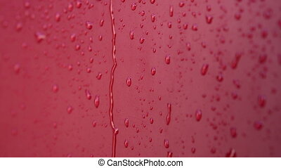 Close up of water drop. Red color