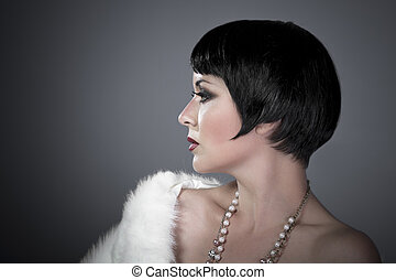 gourgeos female brunette flapper profile wearing pearls and...