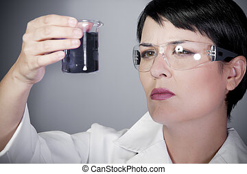 laboratory female personel on research and development,...