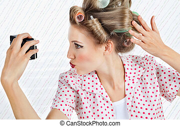Woman Self Photographing Herself - Young woman with hair...