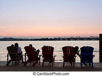 Tourists watch sunset from National Harbor