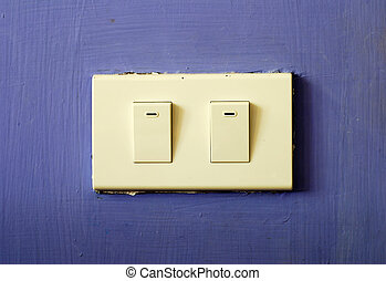 White switch on blue wall