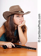 cowgirl a hat with a gun