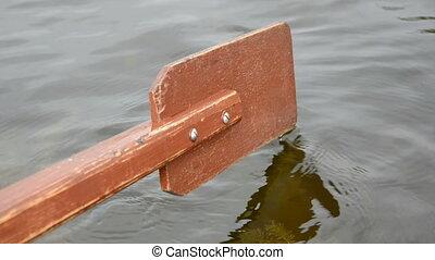 wooden boat oar and water