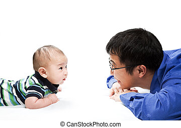 Asian father and son - A shot of an asian father playing...
