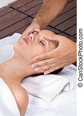 Woman Receiving Head Massage - Beautiful young female...