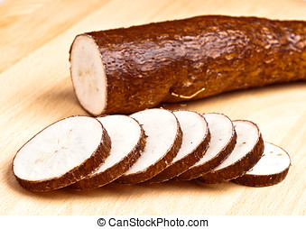sliced yuca on wooden base