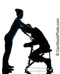 massage therapy with chair - one man and woman perfoming...