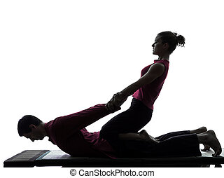thai massage silhouette - one man and woman perfoming thai...