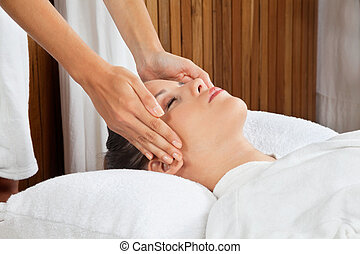 Woman Receiving Head Massage At Spa - Young woman receiving...