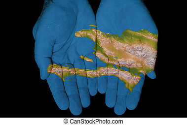 Haiti In Our Hands - Map painted on hands showing concept of...