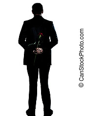 silhouette man back  full length holding a rose flower
