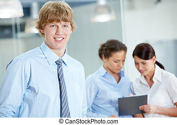 In office - Portrait of attractive smiling male looking at...