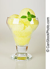 peach and melon sorbet in bowl on a light background with...