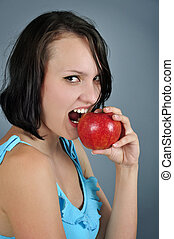 woman eating apple - Pretty young woman eating red apple