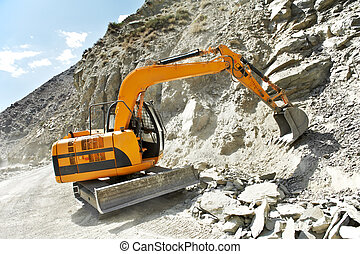 track-type loader excavator at mountain work - track-type...