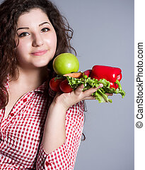 Beautiful girl with healthy food
