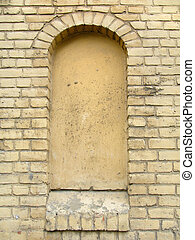 Old, ragged brick wall texture with immured window