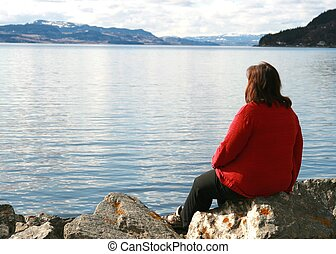 Lonely woman - Lonely overweight woman looking at the ocean