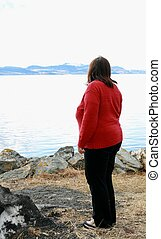 Lonely woman - Lonely overweight woman standing looking at...