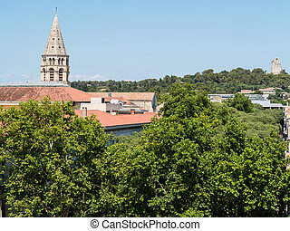 Looking over Nimes at the Tour Magne - A view of a church...