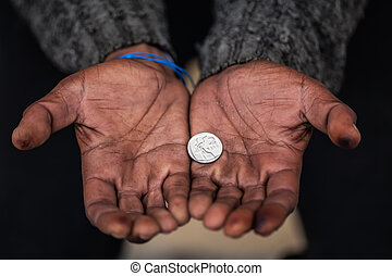 Begging - The african-american man collect a R2.