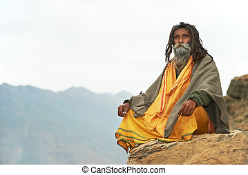 Indian monk sadhu - Indian old monk sadhu in saffron color...