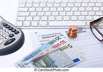 Income tax declaration - Desk with income tax form,...