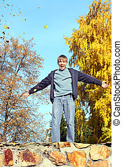 teenager in autumn park - happy teenager in the autumn park
