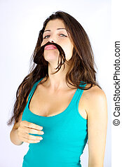 Beautiful woman making funny face with hair as moustache -...