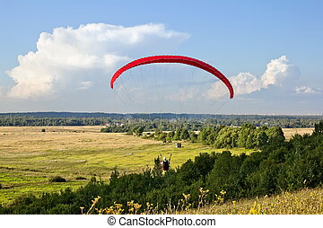 paraglider soar in the air amid wondrous landscape