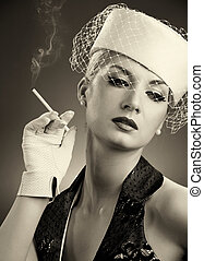 Beautiful smoking woman. Retro portrait - Beautiful smoking...