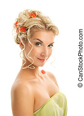Beautiful young woman with fresh spring flowers in her hair...