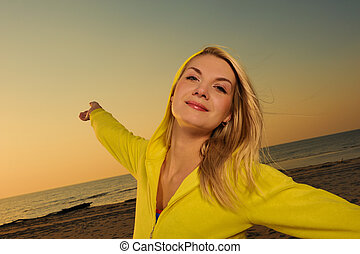 Beautiful woman on a beach at sunset