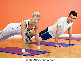 Group of people completing push ups