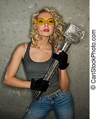 Sexy blonde with big metal hammer
