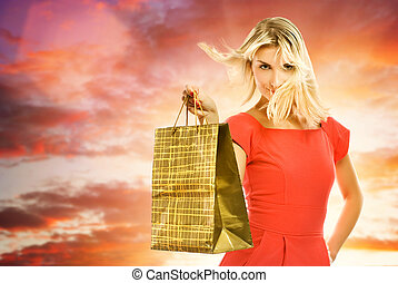 Beautiful young woman with a shopping bag