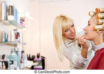 Female hairdresser working in beauty salon