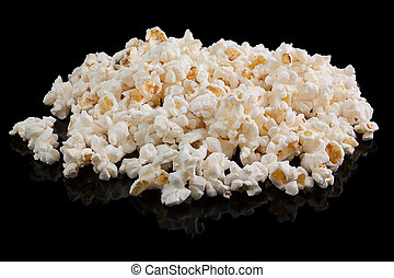popcorn - A pile of popcorn on a black background