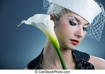 Beautiful young woman with white kala flower