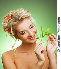 Young woman with green plant Isolated on whte